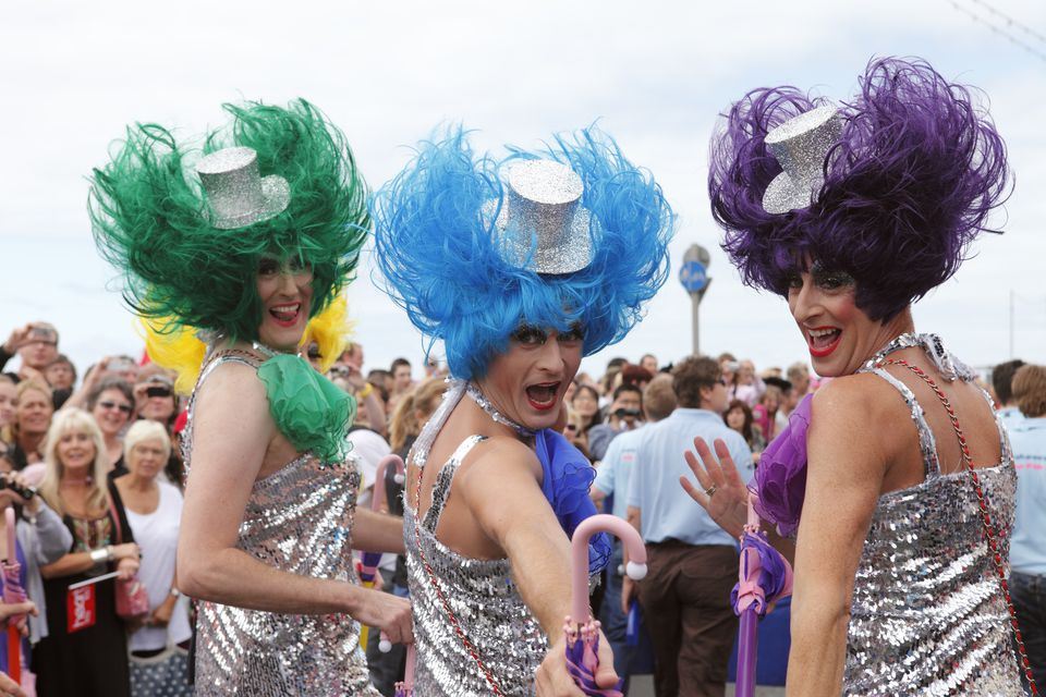 Men take part in the parade around Brighton and Hove during Gay Pride held annually in August to promote equality and diversity and eliminate discrimination of the lesbian, gay and transsexual community, Brighton, East Sussex, England
