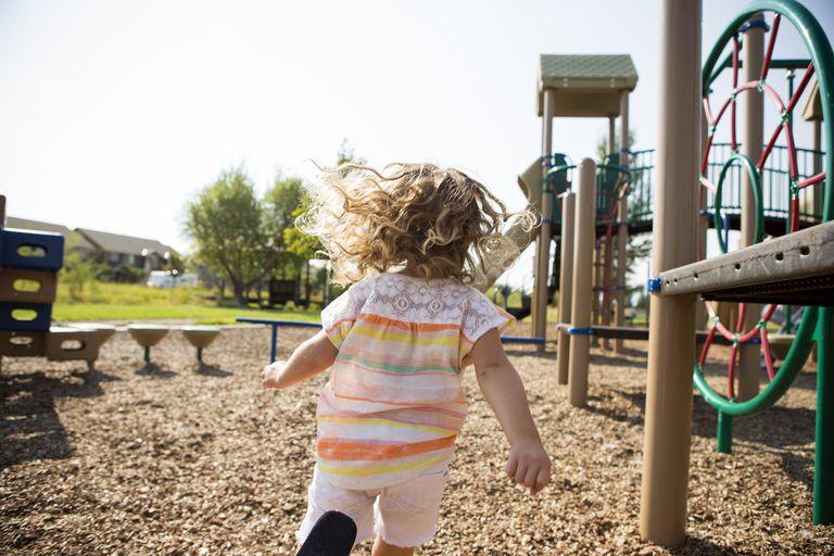 Kid running through playground.