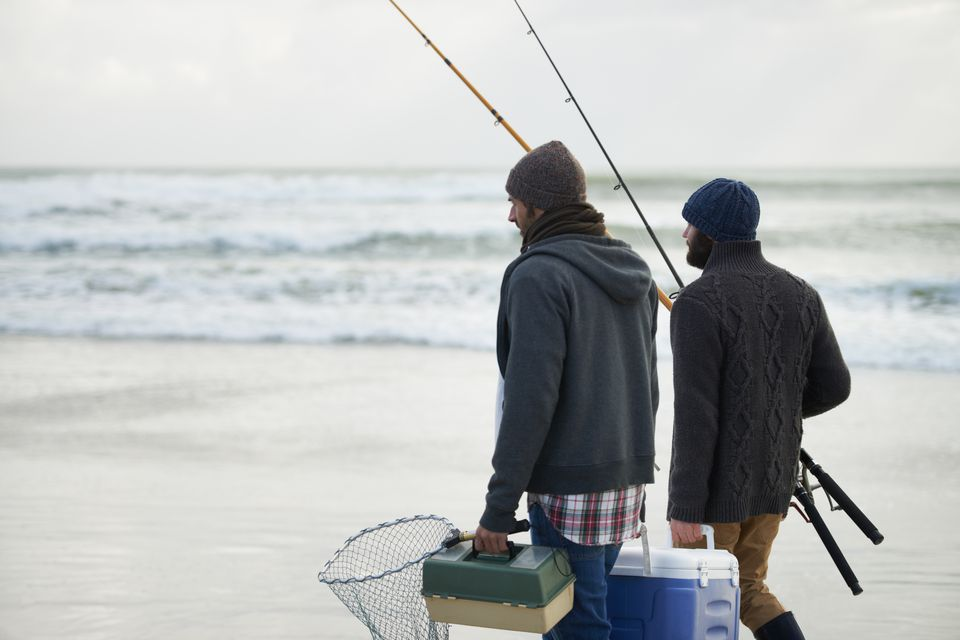 Shot of a two friends going fishing on an early overcast morning