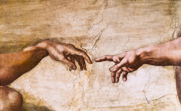 Close-up of God and Adam's hands