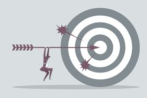 Businessman holding flying archery, shooting on Bull's-Eye of target