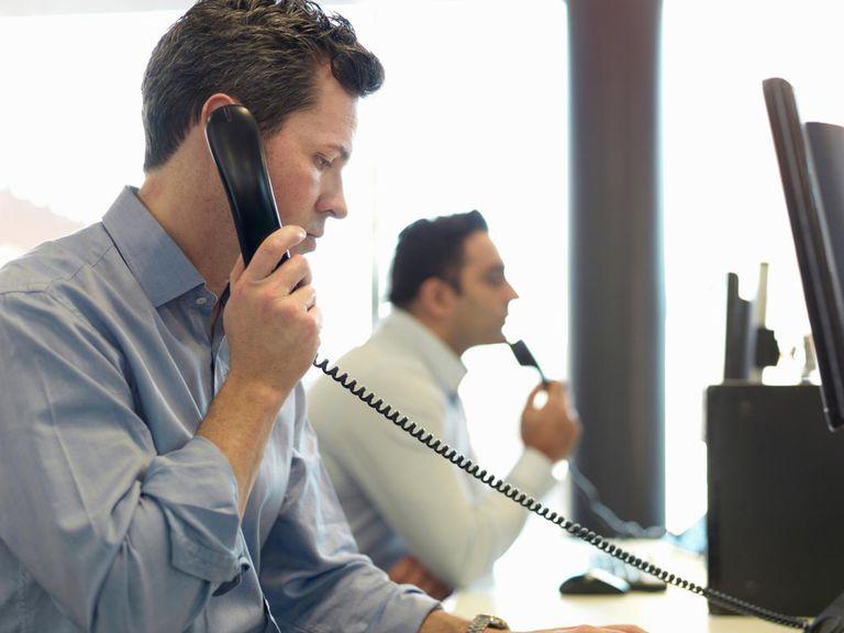 Businessman talking on phone at desk