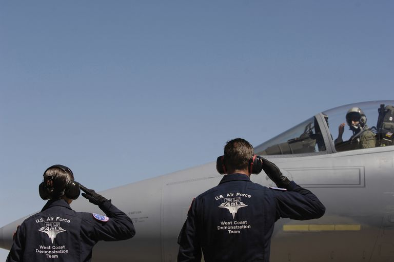 U.S. Air Force Airmen salute the Captain of an F-15 Eagle.