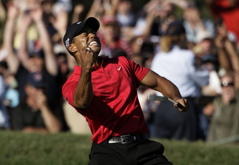 Tiger Woods celebrates after sinking his birdie putt on the 18th hole to force a playoff with Rocco Mediate during the 2008 U.S. Open Golf Championship