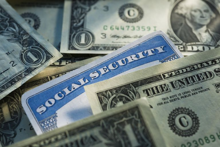 Studio shot of social security card and banknotes