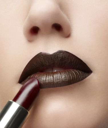closeup of lipstick being applied to lips