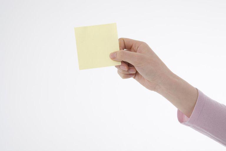 Woman's hand holding memo