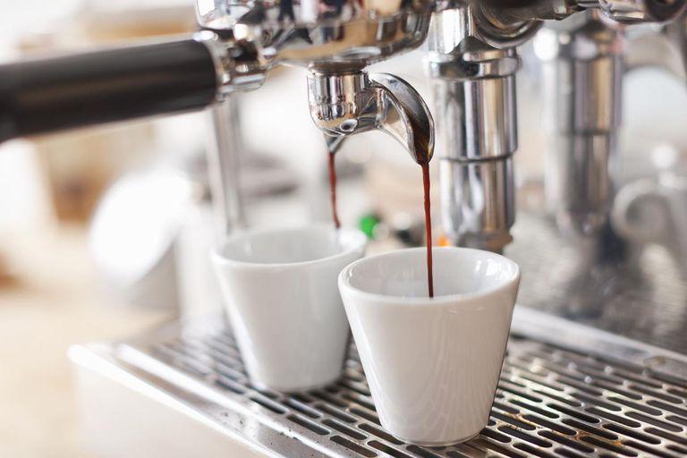 Espresso machine pouring cups of coffee