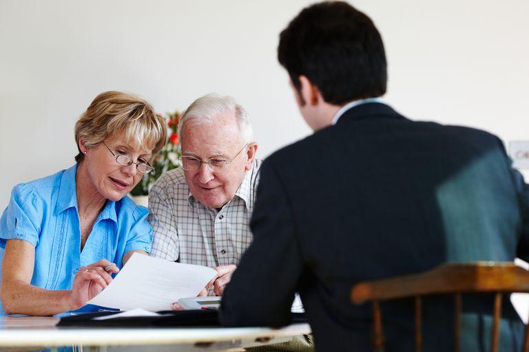 financial consultant advises senior couple