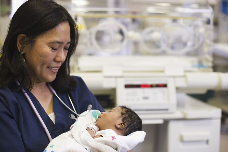 NICU nurse holding preemie baby