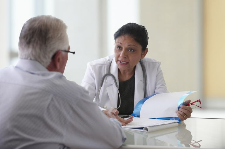 Female doctor discussing test results with patient