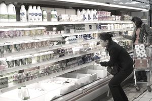 women looking at food labels in grocery store
