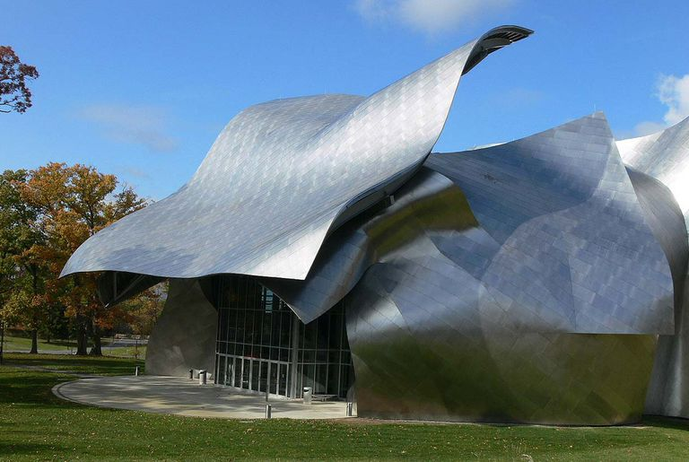 Undulating skin of stainless steel waves over the entrance to a performing arts center in upstate New York