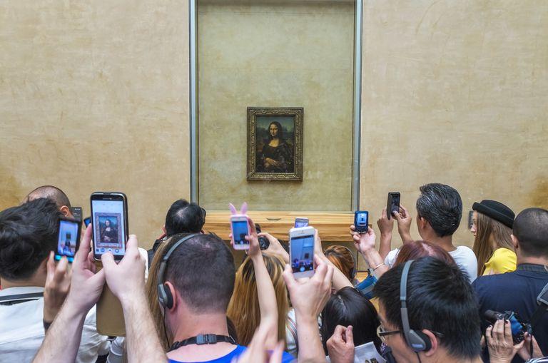 Tourists photographing Mona Lisa, The Louvre, Paris, France