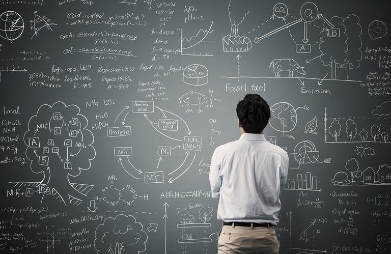 man looking at math problem