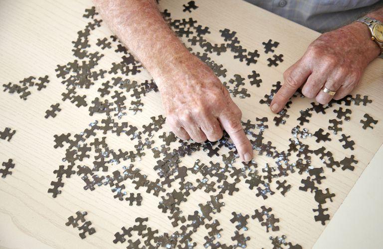 Man doing jigsaw puzzle.