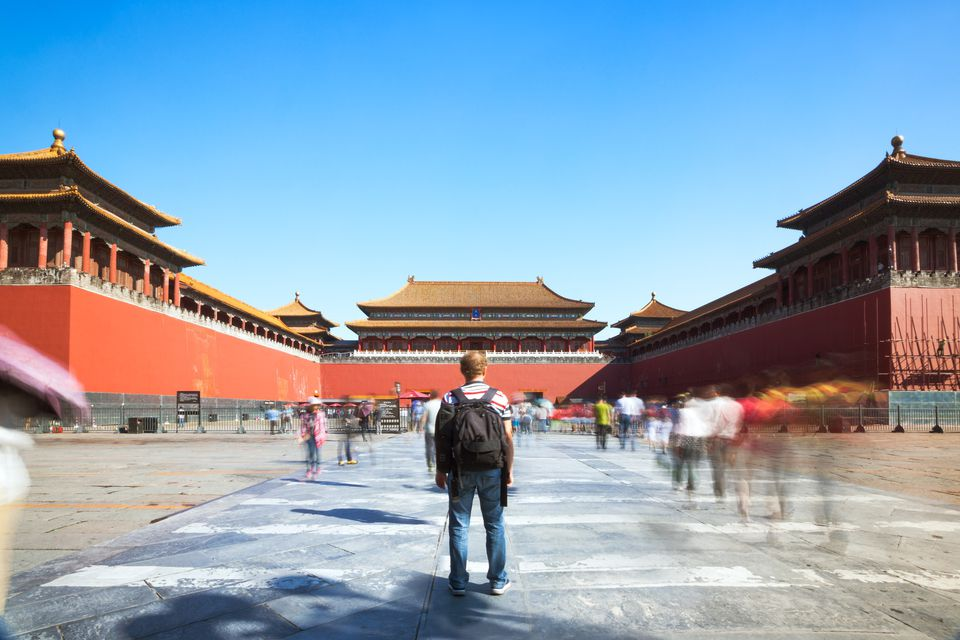Tourist looking at the Forbidden city in Beijing in a sunny day