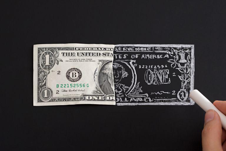Drawing dollar bill on chalkboard