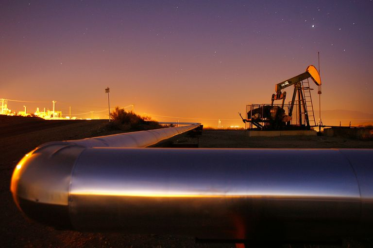 Oil rig and pipeline at night