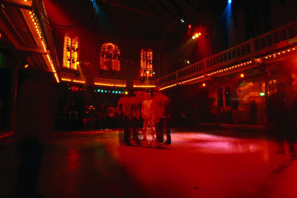 A small group of revellers on the dance floor on Student Night at the Paradiso, a night-club in a converted church on Weteringschans.