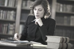 Women studying 401(k) terms like distribution and withdrawal.