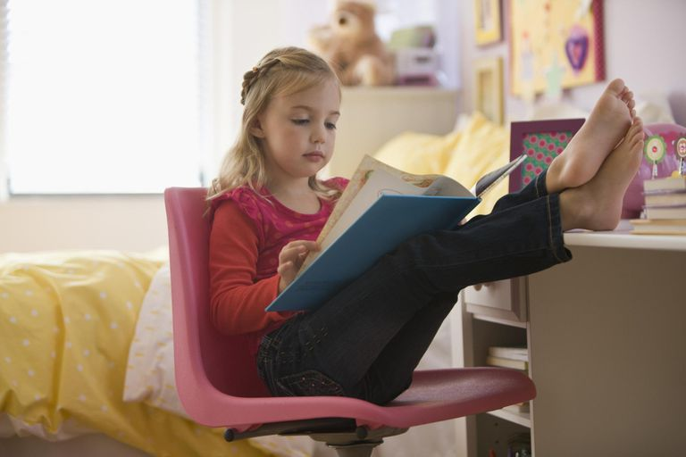 girl reading book with feet up