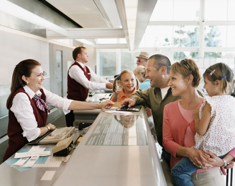 Passengers at Airport Check-in Desk