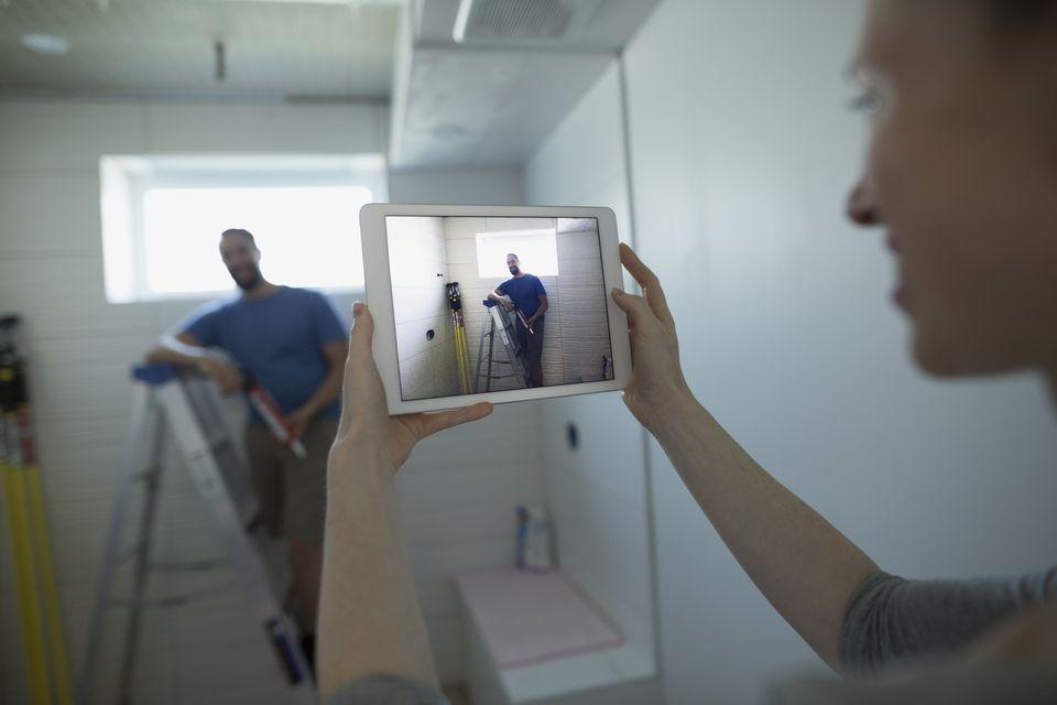 Woman recording home improvement video