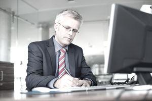 Mature businessman working at his desk