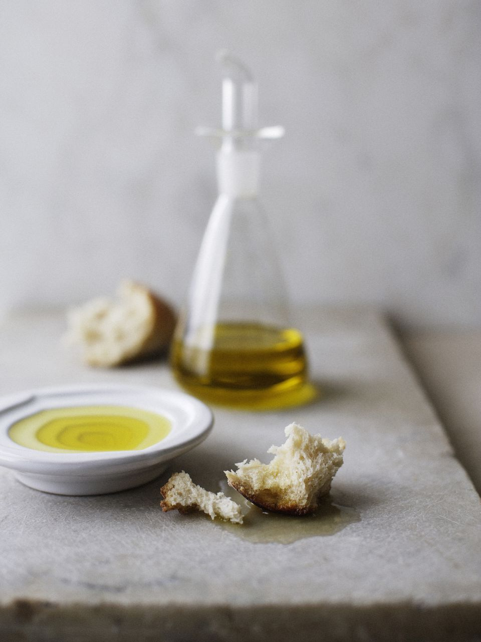 Plate of olive oil with crusty bread