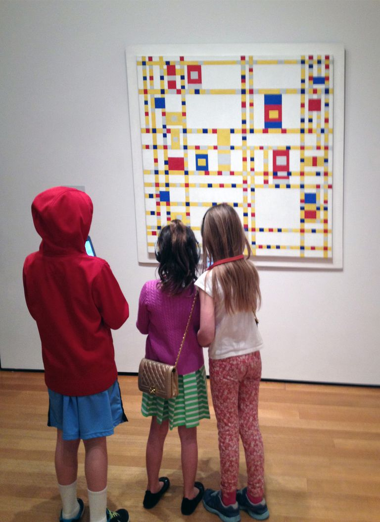 Children looking at the focal point in a painting by Piet Mondrian.