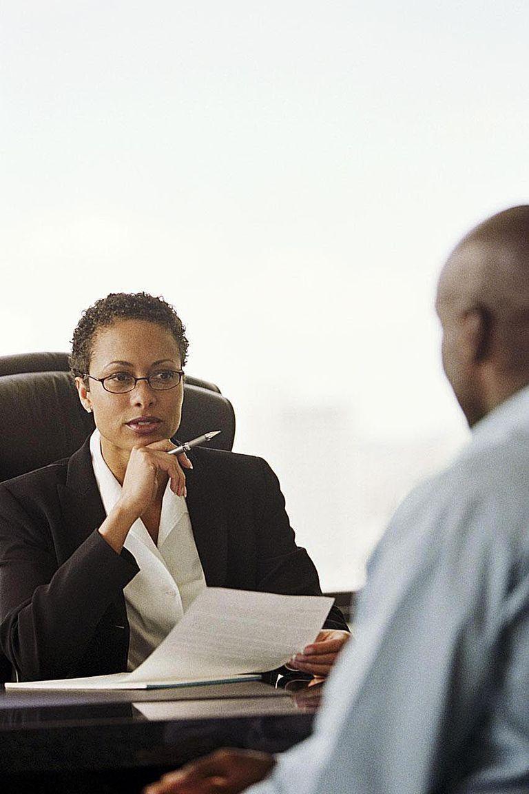 Businesswoman interviewing man (focus on woman)