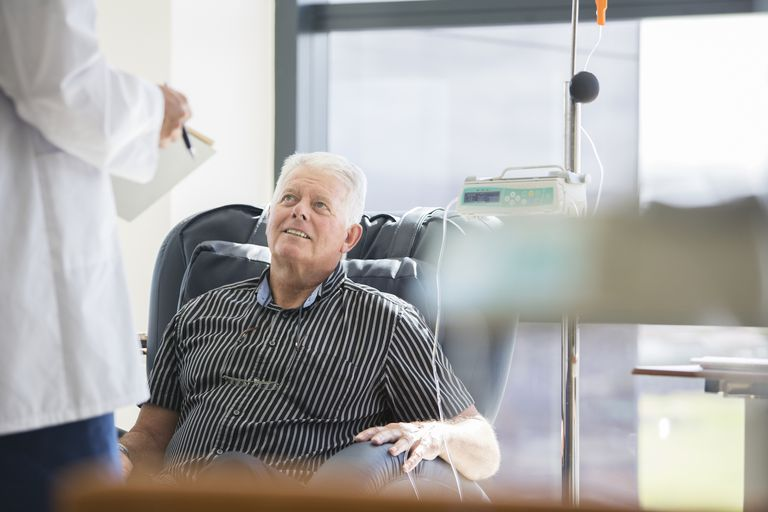Doctor talking to a patient receiving treatment