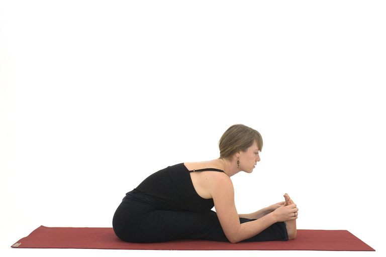 woman doing a seated forward bend