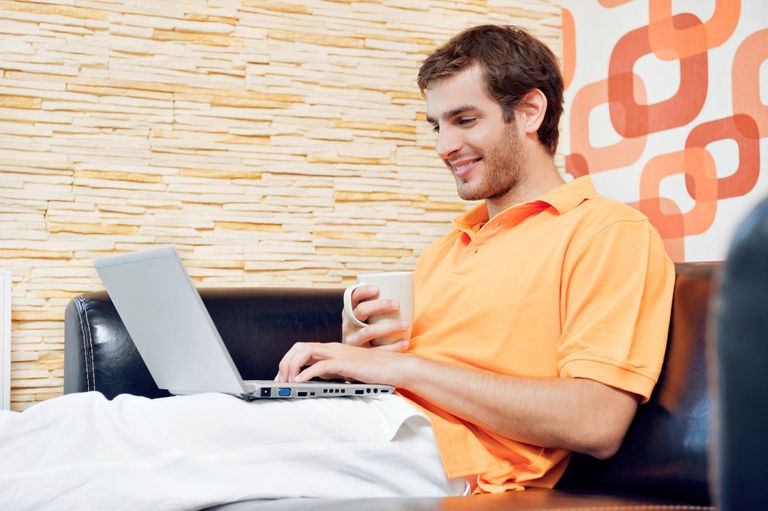 Man using laptop in the living room