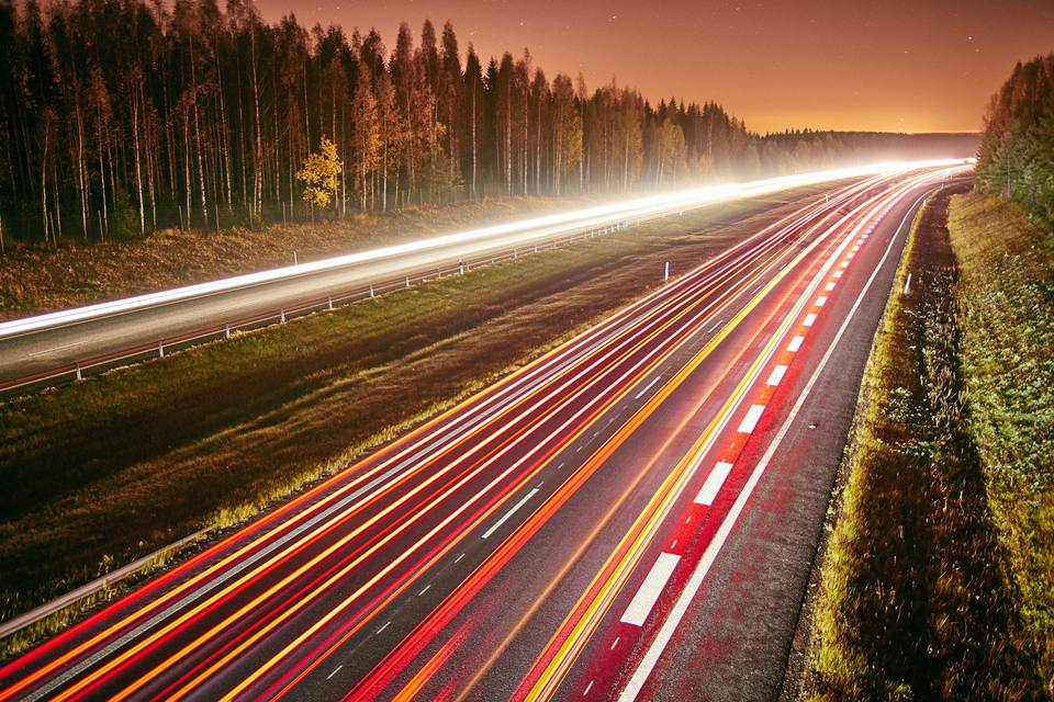 nighttime time lapse of a highway in Finland