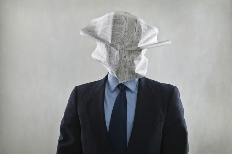 Man With Newspaper On Face