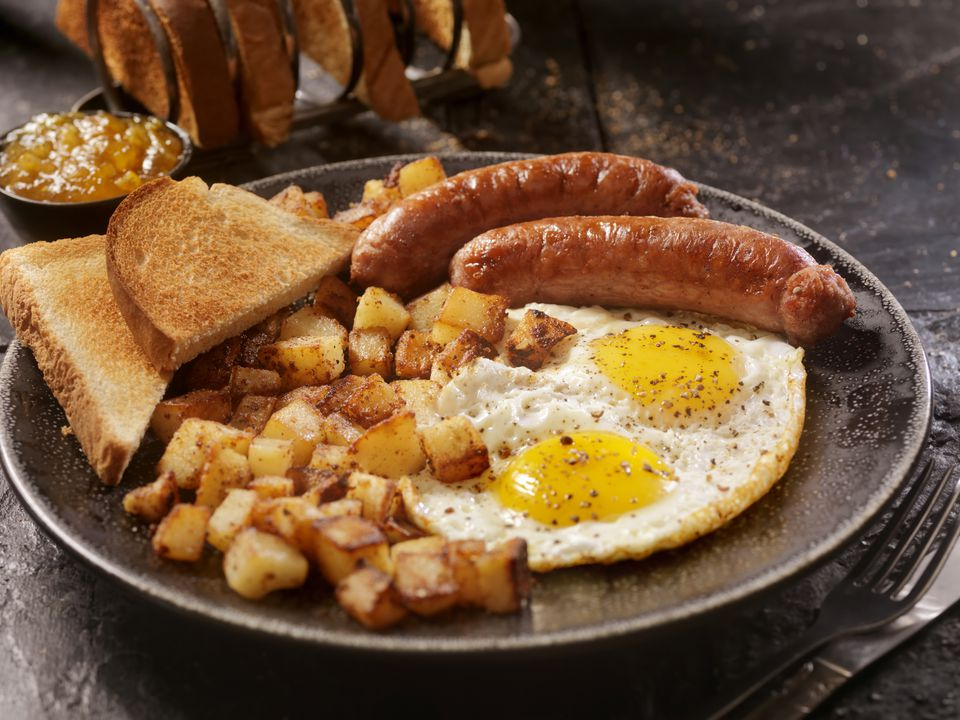 Breakfast with Sunny side up eggs and Sausage Breakfast with Sunny side up eggs, sausage, hash browns and toast