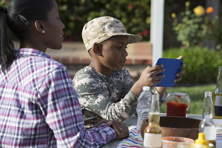 Military Mother on a picnic with son.