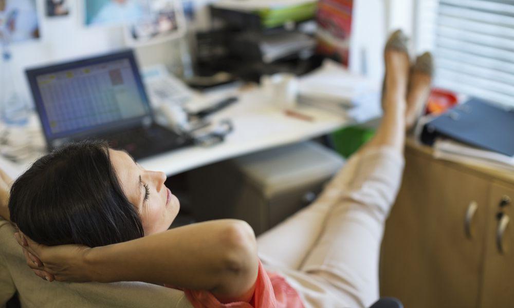 Woman procrastinating at work