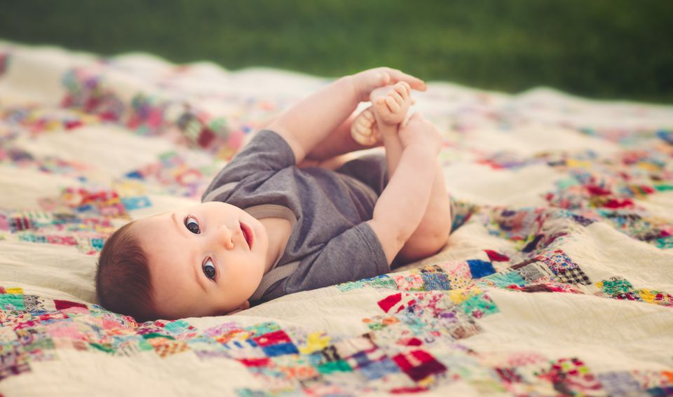 Baby Boy On Vintage Quilt