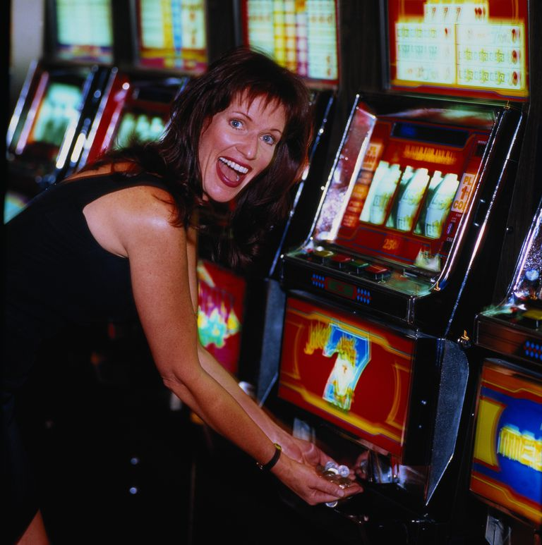 A happy slot machine player