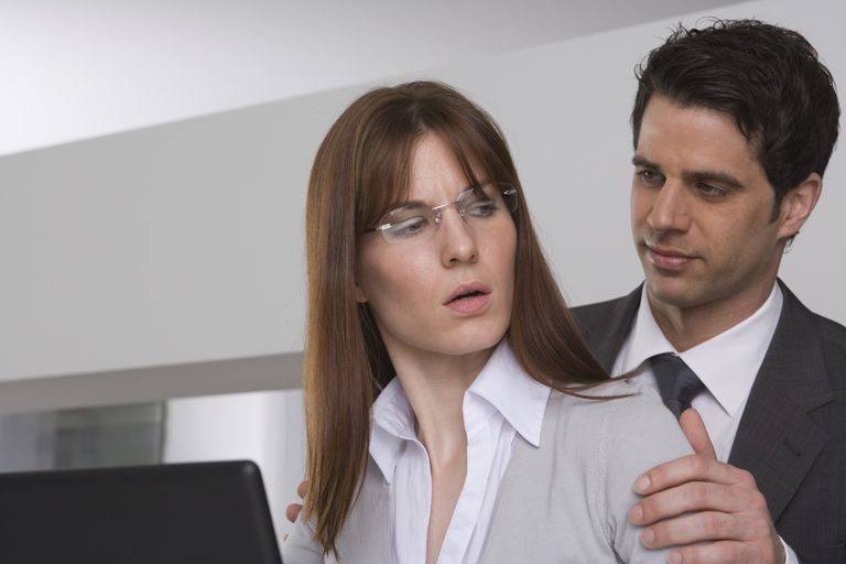 Woman experiencing touching by a male coworker