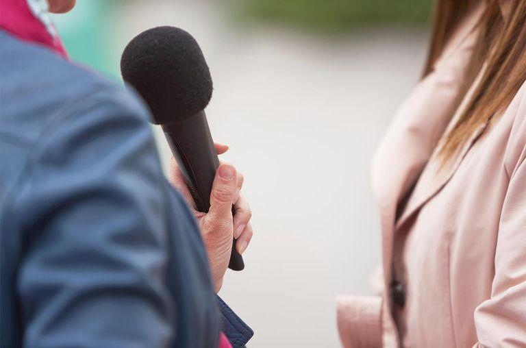 journalist interviewing woman