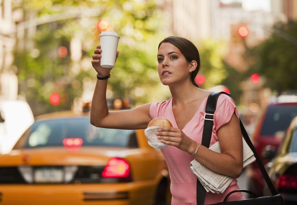 Woman hailing cab