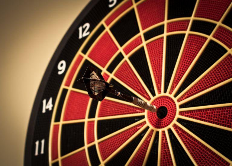 dart board with dart on target