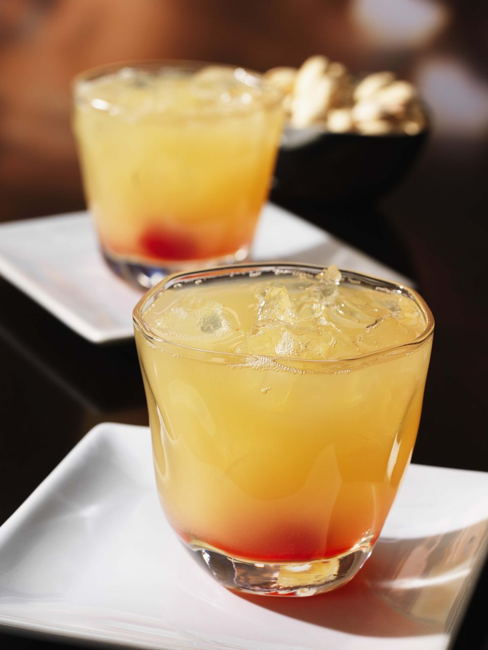 Kick back with 2 tasty tequila sunrise cocktail recipes for Best tequila shot recipes