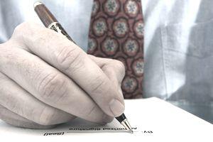 man signing agreement