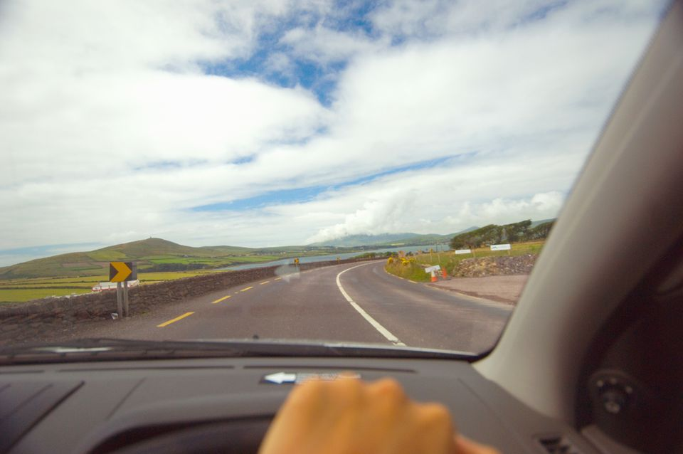 Person driving car along Dingle Peninsula