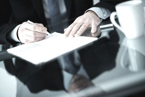 Businessman signing a letter